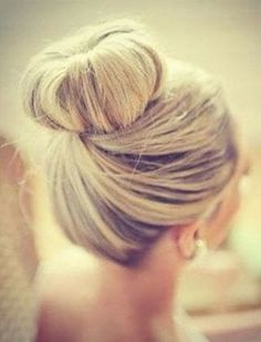 Beautiful sweeping top knot - I need to learn how to do this.