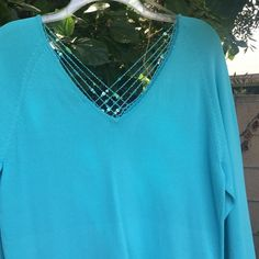 3/4 sleeve rayon and nylon sweater /sequin trim Beautiful NWT turquoise  V neck front and back sweater with sequin string trim on bodice and sleeves. Sweaters V-Necks