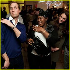 Britain's Prince William, Duke of Cambridge dances with Vanessa Boateng, as his wife Kate, Duchess of Cambridge, looks on during a visit to Centrepoint's Camberwell Foyer in London on Wednesday, Dec. 21, 2011. The national charity, Centrepoint, provides housing and support to improve the lives of homeless young people aged 16-25. (AP Photo / Ben Stansall, Pool)