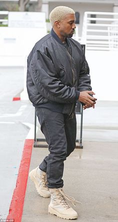 Where's Kim? Kanye West stepped out solo in LA on Monday for lunch at a Brentwood restaurant