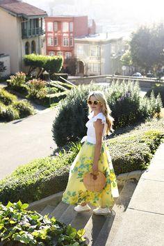 Blair Eadie of Atlantic-Pacific back in San Francisco (from NYC!) wearing a Lela Rose Skirt, Basket Bag, Loeffler Randall shoes and yellow sunglasses.