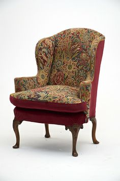 Traditional Wing Chair  Reupholstered using existing tapestry with new ruby red velvet fabric finish with red braiding.