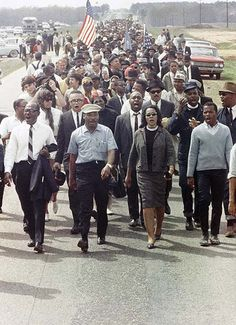 Martin Luther King Jr and his wife Coretta leading a Peace March in Georgia