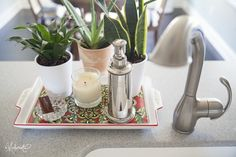 Nice organized way to keep soap dispenser/candle, etc. on counter island with sink