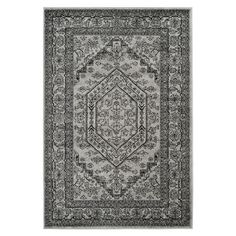Add a refined touch to your living room or master suite with this eye-catching rug, showcasing a Persian-inspired motif in silver and black.   ...