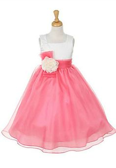 This dress is the epitome of class and elegance and though it is simple in design, it is rich in appeal. The satin bodice features a square neckline and is accented by a sash and three dimensional flower. The full skirt is perfect for all types of special occasions and will turn your little one into a princess the minute she puts on the dress. The sash can be tied in the back for the perfect fit and bow the features a zipper closure. NOTE: The bodice top on this dress is Ivory and is only…