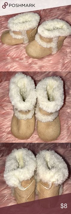 Baby Boots with faux tan suede and cream fur Baby Boots with faux tan suede and cream fur, New without tags never worn. My baby grew before she could wear these adorable boots! Get them just in time for fall 🍂 and winter ❄️! Baby size 1 Cinderella Shoes Boots