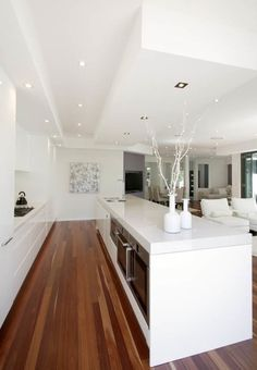 white kitchen - island bench with oven etc to overlooking living room modern kitchen by Kitchens By Design Australia