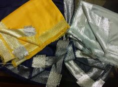 Cashmere stoles with shimmer borders