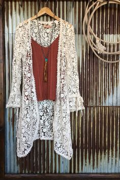 Ivory crocheted lace duster/cardi Crocheted ties at waist and cuffs Flowy cuffs Rounded hem Flowy thru bodice Fun piece to create many boho/festival or romantic
