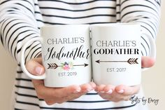 Choose style: (Godmother)MUG A: Style 1 or 2 (Godfather)MUG B: Style 1 or 2  IN THE NOTE TO SELLER: please write: Name and est. year  Perfect gift for Godparents or a way to ask them!  You will receive (2) mugs (1) ONE: Godmother (1) ONE: Godfather Mugs Size: 11oz *Printed on both Sides *Dishwasher + Microwave Safe *Ceramic Mug  Our process of making the mugs is the design in permanently fused onto the mug, no stickers! This design will stay on forever!  Godfather mug…