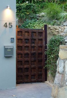 Love this old world gate fused with this modern look & the Neutra style Urban + Luxury Old World + Modern Masculine + Feminine. The duality creates the most beautiful harmony. Entrance Gates, Grand Entrance, Fence Gate, Fences, Castle Gate, Wooden Gates, Rustic Doors, Iron Gates, Gate Design