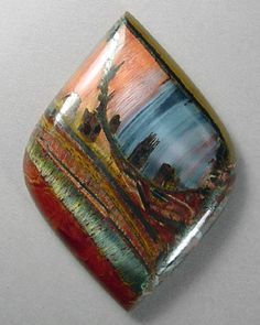 <3 Wow! waterfall, trees, lil cabin, landscape.... seriously is this real? gems are so amazing! Marra Mamba tigereye cabochon by Sam Silverhawk gemstones.