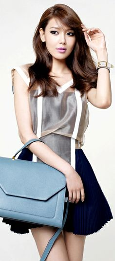 Sooyoung from Girls Generation! To be honest, I'm not much of a huge fan of GG, but I think Sooyoung is beautiful!! ^^