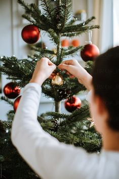 Boy decorating for Christmas by Zoran Djekic - Stocksy United Christmas Tree Trimming, Merry Christmas Pictures, Christmas Tree Pictures, Christmas Photo Cards, Christmas Wishes, Family Christmas, Christmas Tree Decorations, Christmas Classics, Xmas