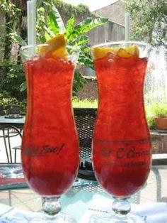 New Orleans Hurricane   1 1/2 ounces light rum 1  1/2 ounces dark rum 1 oz. orange juice 1 oz. lime juice 1/4 cup passion fruit juice 1 tsp. sugar 1 tsp. grenadine Ice cubes Orange slices and cherries for garnish