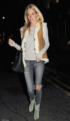 Autumn on the way: Blonde Poppy looked snug in skinny jeans, a grey knit jumper, a fur-lined gilet and boots