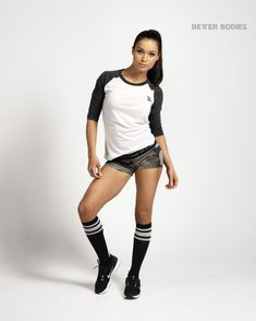 Better Bodies green camo hot pants shorts teamed with black knee high socks and a baseball tee.