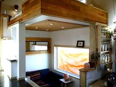Sleeping loft above living room below, Modern sleek design and using the wood for a beautiful natural look. Love the floating feel of the loft. Best of all: It's on wheels!