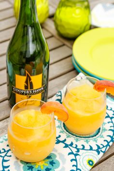 Wine Slushies -- these Peach Moscato Wine Slushies are a cinch to serve to guests when you make your own frozen wine slush mix ahead of your gathering. When guests arrive, simply blend, garnish and serve!