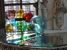 glass floats in a wire basket