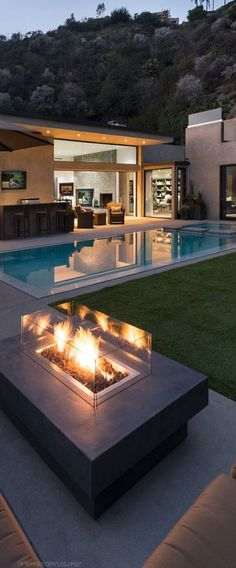 The fireplace. Stunning outdoor space | via @homedsgn