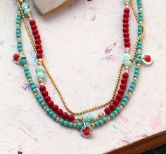 Multi Beaded Strand Necklace With Dangles in Red by octaviabloom
