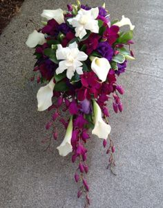 Beautiful cascading bouquet with Gardenias, Mini Callas, Dendrobium Orchids, and Lisianthus