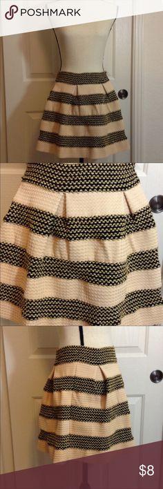 Cream / gold / black full skirt Size medium Cream / gold / black full skirt. No size tag, but I'm a medium and it fits. Thick material. Skirts Mini
