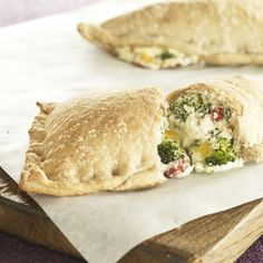 Broccoli Three-Cheese Pizza Pockets 	      Broccoli, peppers, and three cheeses make a tasty filling for this pizza pocket. Best of all, it's ready in 35 minutes.