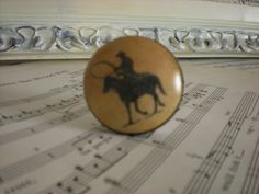 Western Knob-Cowboys-Horses-Drawer Knob-Lodge-Rustic-Cabin Decor-Dresser Knobs-Porcelain Knobs-Antique Knobs. $4.50, via Etsy.
