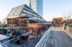 GAD Architects stacked a series of recycled shipping containers on top of a fancy shopping mall in Istanbul to create this remarkable modern day bazaar.