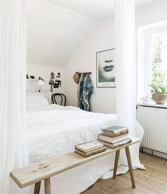 The white drapes create a cosy nook in the bedroom. * It´s rounded off by the rustic bench at the bed end. | via: madogbolig.dk