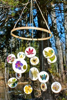 After pressing flowers, make this mobile to hang in the backyard with the girls.