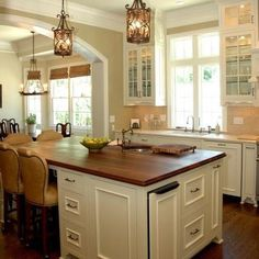 I usually like dark wood in kitchens, but this one is nice.