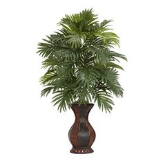 Evoke a tropical paradise with this lush faux areca palm tree, showcasing lifelike trunks with cascading fronds.    Product: Faux ...