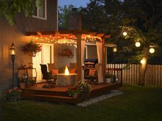 My Summer Project - Glamourizing the Pergola hanging baskets, lights, flowers This lighted back pergola will be my inspiration