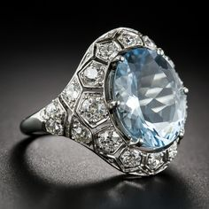 Art Deco Aquamarine and Diamond Ring hand fabricated in platinum - circa The glistening carat gemstone is embraced all around with carats of bright-white European-cut diamonds glittering from within mostly individual honeycomb style settings. Gems Jewelry, Gemstone Jewelry, Jewelery, Fine Jewelry, Art Deco Ring, Art Deco Jewelry, Jewelry Design, Victorian Jewelry, Antique Jewelry