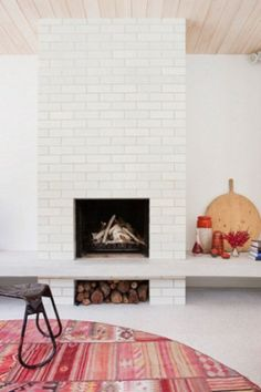 white brick / fire / colorful rug