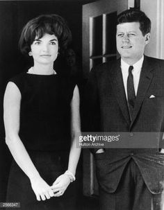 American First Lady Jacqueline Kennedy (1929 - 1994) stands with her husband, President John F. Kennedy (1917 - 1963), in the door of the White House, Washington, D.C., circa 1961.