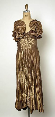 Evening dress  Designer: Gilbert Adrian Date: late 1940s Culture: American Medium: metallic thread, silk Accession Number: 1977.120.5a, b