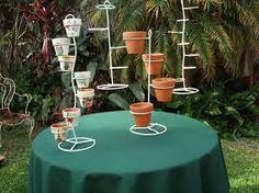 Resultado de imagen para maceteros de hierro para cactus