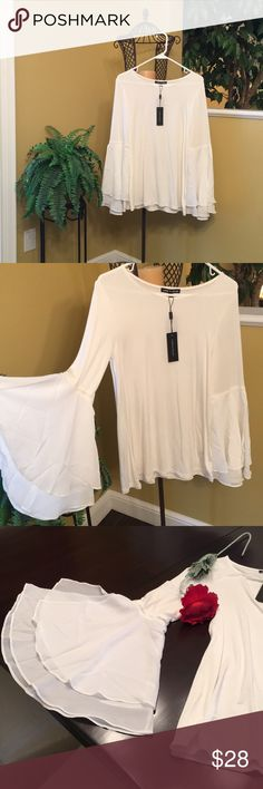 Bell sleeve top It's 95% viscose and 5% spandex. The sleeves are bell sleeves with 3 their layers and detailing above the sleeve and are 100% polyester. Machine washable. BNWT! This too is super comfy. I love it but with an 7 month old it would likely get in the way with feedings and diapering 😬. It's been in my closet since October and it should have a home where it can be worn. Cable & Gauge Tops Blouses