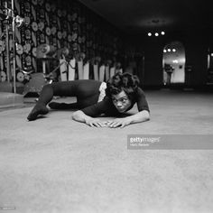 American singer and actress Eartha Kitt (1927 - 2008) exercising at the Town and Country Health Salon in Knightsbridge, London, 1st April 1965.