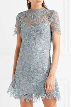 Sky-blue guipure lace Tie and zip fastening at back 100% polyester Hand wash