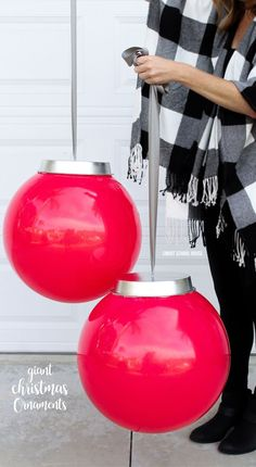 Giant Christmas Ornaments. Kids play balls and a cake pan from the dollar store! How to Make Your Own Huge Outdoor Christmas Ornaments (Easy video tutorial) #DIYHomeDecorDollarStore