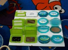 sensory board out of wet wipes lids