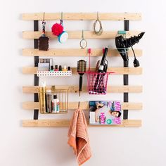 This clever storage rack made out of IKEA bed slats can be used for beauty supplies magazines or even kitchen essentials!Click the link in our bio to see more DIY dorm room hacks! Dorm Room Storage, Dorm Room Organization, Ikea Storage, Storage Ideas, Hanging Storage, Storage Hacks, Wall Storage, Closet Storage, Organization Hacks