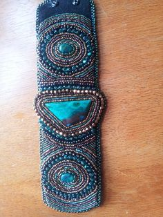 Third embroidered bracelet flat view