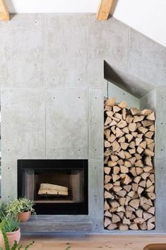 Firewood Storage Concrete Fireplace Design Discover the hallmark of a truly well-appointed home with the top 60 best concrete fireplace designs. Explore luxury and minimalistic interior ideas. Wooden Fireplace, Concrete Fireplace, Concrete Houses, Home Fireplace, Marble Fireplaces, Fireplace Remodel, Fireplace Surrounds, Fireplace Design, Fireplace Mantels